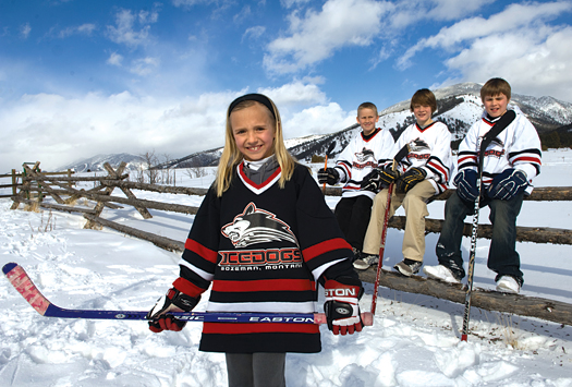 Bozeman Ice Dogs youth hockey players Meggie Delaney, Nate Hope, John D'Agostino and Mick Delaney get outside and enjoy a beautiful Montana winter day.