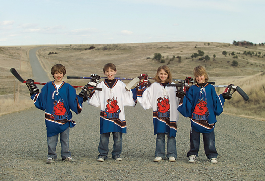 Youth hockey players, from left, Brendan O'Donnell, Dylan Chirrick, Cody Gagnon and Emily Reimche are ready to embark on a long journey of fun playing hockey in Billings, Mont.