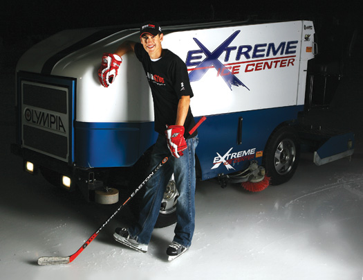 Despite a hectic racing schedule, Joey  Logano manages to find time to return to the Extreme Ice Center in Indian Trail, N.C., the host site of the 2009 USA Hockey  National Championships at the Tier I & Tier II 12 & Under divisions.