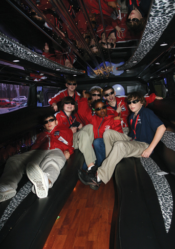 The Charlotte Jr. Checkers kick back inside a limousine on their way to the rink.