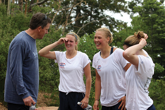 U.S. Women's Team Head Coach Mark Johnson shares a few laughs with several of his players at the top of the mountain.
