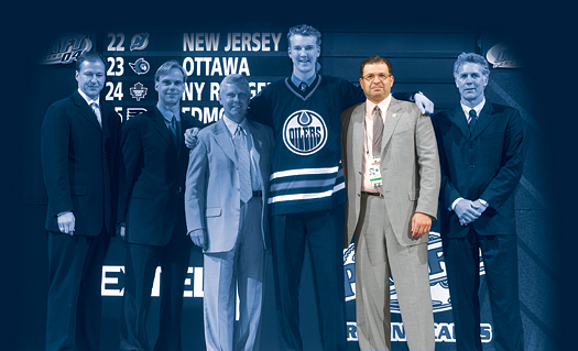 Bob Mancini, second from right, at the 2004 NHL Entry Draft with Edmonton Oilers first round pick Devan Dubnyk.