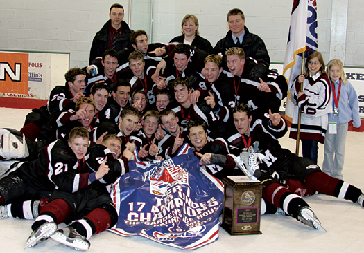 Players from the Shattuck-St. Mary's team that won the 2003 USA Hockey Tier I 17 & Under National Championship crowd around their winnings in Laurel, Md.
