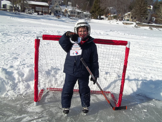 Flat Stanley Cup & 7-year-old Jeremy Hansen take in some pond hockey on Lake Shirley in Lunenburg, Mass.: Photo submitted by Kelly Hansen