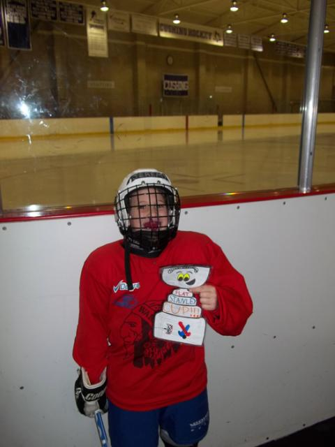 Flat Stanley Cup visiting Cushing Academy's Lorio Arena in Ashburnham, Mass., with Jeremy Hansen (7) of the Ash-West Warriors hockey team.: Photo submitted by Kelly Hansen