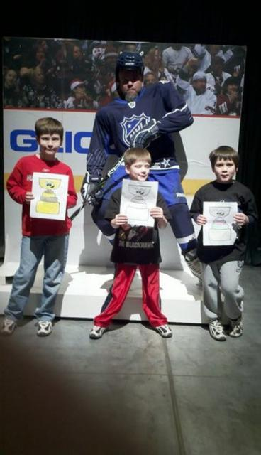 Four all-stars show off their Flat Stanley Cups in Raleigh, N.C. during this year's All-Star game: Photo submitted by Travis Kutchma