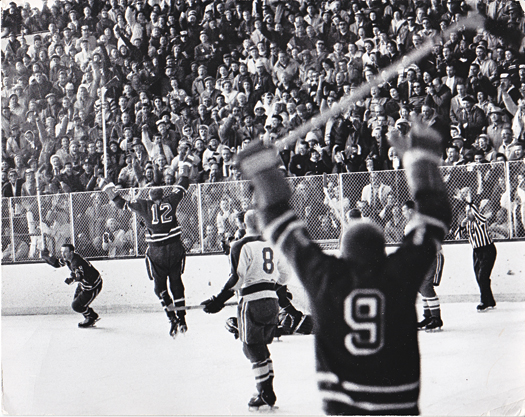 Members of the U.S. Olympic Team celebrate the first golden moment for the United States.