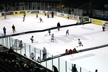 Youth hockey associations are finding that cross-ice hockey is a great way of getting more kids on the ice for less cash. It also helps with skill development and allowing kids to have more fun because they touch the puck more often in a practice or game.