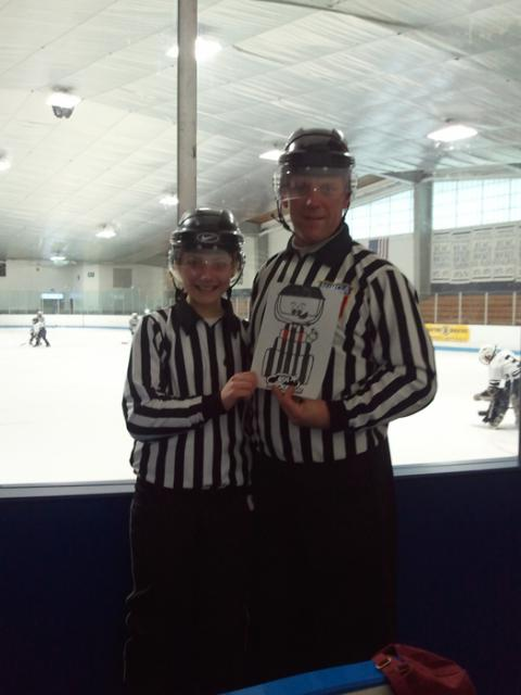 Flat Stanley cup ref was at Meg Sheeran's first reffing assignment on Sunday with her father Mike, reminding all refs to wear a shield.: Photo submitted by Mike Sheeran