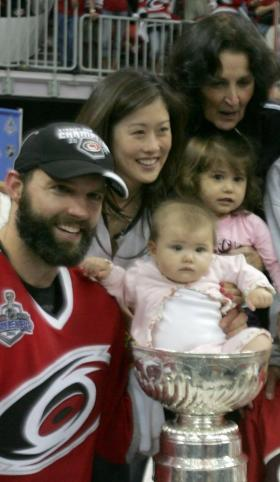 Figure skating Kristi Yamaguchi, husband Bret Hedican of the Carolina Hurricanes and family celebrate with the Stanley Cup after defeating the Edmonton Oilers in game seven of the 2006 NHL Stanley Cup Finals (Jim McIsaac/Getty Images)
