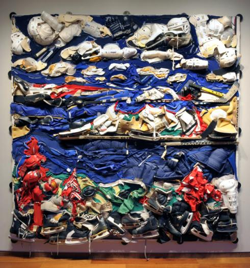 "Apple Island, tiled digital printout and hockey gear on plywood, 96"" x 96"", 2006. – Liz Pead: http://www.worldofthreadsfestival.com/artist_interviews/032_liz_pead_11.html"