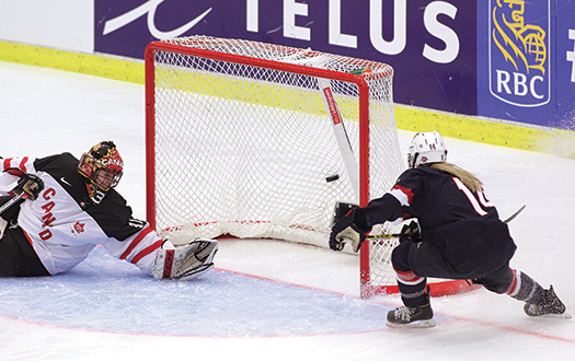Brianna Decker, 14, converts a pass from linemate Hilary Knight for what would prove to be the winning goal in the U.S. Women's National Team's 7-5 victory over Canada in the 2015 IIHF Women's World Championship in Malmö, Sweden.