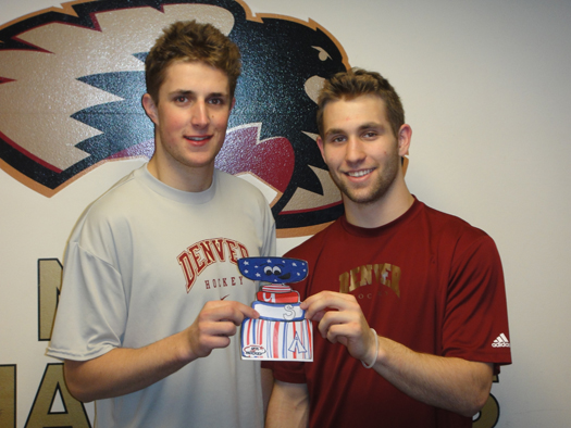 University of Denver players & NTDP alums, Drew Shore and Jason Zucker take a picture with Flat Stanley Cup.: Photo submitted by Nick Meldrum