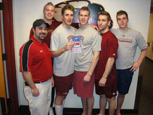 American boys, Drew Shore, Nick Shore, Jason Zucker, Matt Donovan and Adam Murray show Flat Stanley Cup around the DU lockerroom: Photo submitted by Nick Meldrum