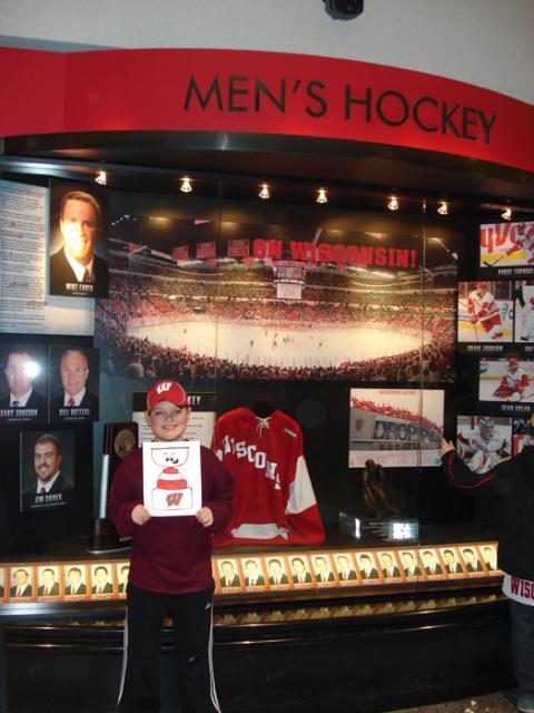 Matt Gellert and Flat Stanley checking out Wisconsin Badger's Hockey history.: Photo submitted by Suzanne Doody