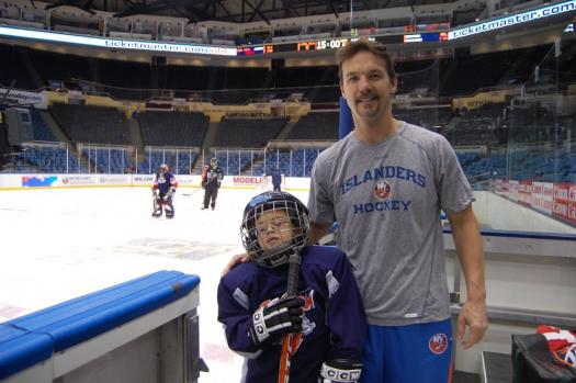 Islanders Assistant Coach Scott Allen with a young Special Hockey player