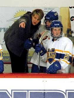 In her first full season as the head coach of the St. Scholastica women's hockey team, Jackie MacMillan led the Saints to a respectable 7-16-2 record, that included 10 losses by one goal.