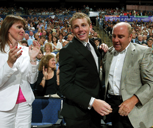 Patrick Kane is congratulated by his mother Madonna and father Patrick before  slipping on the Chicago Blackhawks jersey at the 2007 NHL Entry Draft.