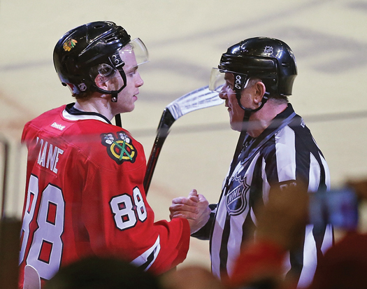 Chicago Blackhawks superstar Patrick Kane was among the players from both teams to wish retiring linesman Andy McElman well after his 1,500th and final NHL game at the United Center on April 3, 2016.