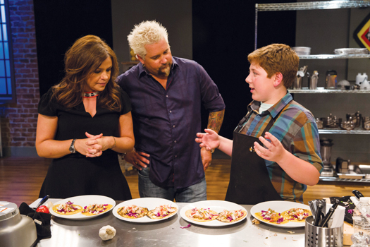 "Gibson appeared on the Food Network's ""Rachel vs. Guy: Kids Cook-Off"" show and won his own three episode series on the channel's website."