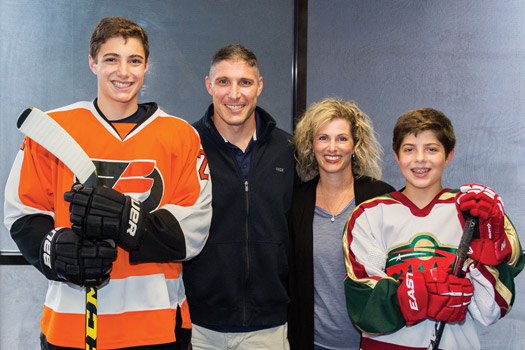 Hockey is a family affair for Col. Michael Hopkins, his wife, Julie, and sons Ryan, left, and Lucas in the Houston area.