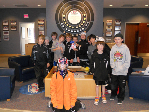 This youth team stops by for a quick photo at the USA Hockey National Headquarters in Colorado Springs, Colo. during their President's Day Tournament.: Photo submitted by USA Hockey Magazine