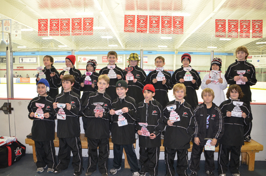Dedicated fans decorated Flat Stanley Cups for the Squirt A Storm White team (Raleigh, N.C.) at the Congressional Midwinter Classic in Washington D.C.