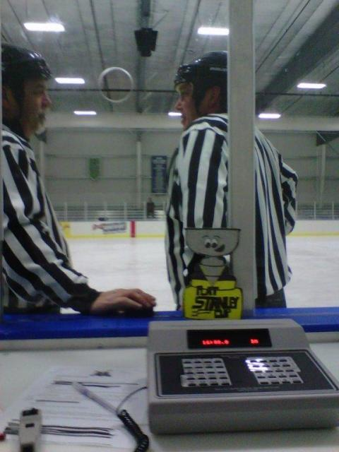 Flat Stanley Cup takes over the scoreboard at the Canlan Ice Arena in Fort Wayne, Ind., as the refs discuss a call.: Photo submitted by Rita Foster