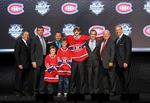 NHL Commissioner Gary Bettman (L) poses with Alex Galchenyuk (4th R), third overall pick by the Montreal Canadiens and Canadiens representatives on stage during Round One of the 2012 NHL Entry Draft.(Photo by Bruce Bennett/Getty Images)