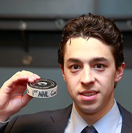 Days after his Boston College Eagles were bounced from the NCAA tournament and then winning the Hobey Baker Award, Johnny Gaudreau scored his first NHL goal with the Calgary Flames.