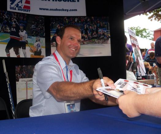 Bret Hedican signs autographs at the 2012 Olympic Celebration in downtown Colorado Springs, Colo. (Justin Felisko/USA Hockey Magazine)