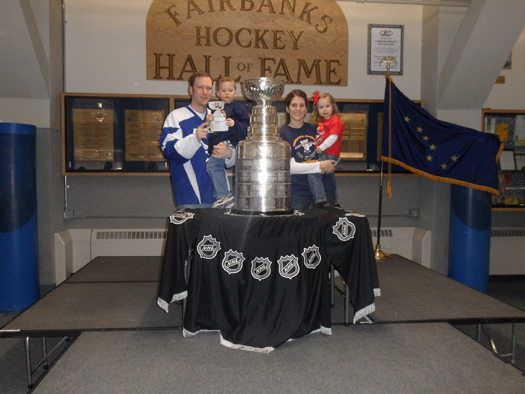 Flat Stanley Cup gets to check out the real Stanley Cup at Fairbanks, Alaska's Hockey Week in Fairbanks celebraion.  Jack (holding Flat Stanley Cup), sister Anne, and mom and dad (Mark and Lana) enjoyed checking the Stanley Cup's first ever visit to Fairb: Photo submitted by Mark Jendro