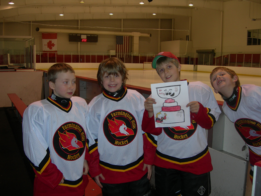 Jake, Max, Tommy and Brendan at their hockey tournament in Holland, Mich.: Photo submitted by JJ White