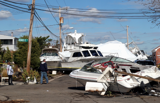 Boats littered Hudson Ave., in Freeport, N.Y., in the aftermath of Hurricane Sandy, that hit the East Coast in early November 2012 causing millions of dollars in damage.
