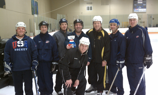 Coaches from Colorado Springs 8U program take a break for a photo-op with Flat Stanley Cup: Photo submitted by USA Hockey