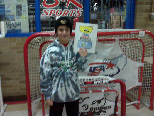 Flat Stanley Cup brough Ben Presley & his team luck at the SilverSticks International Finals, winning the Championship.: Photo submitted by Meg Presley