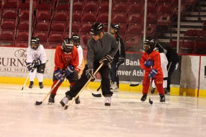 Andy Karofsky skates with Mohamed Abdirahman. The camp began the week with many basic skating drills
