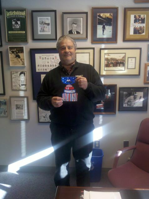 Flat Stanley Cup stops in 1984 US Men's Olympic Coach, Lou Vairo's office on a tour of the USA Hockey National Headquarters in Colorado Springs, Colo.: Photo submitted by USA Hockey Magazine