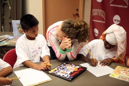 Rosendo Jimenez and Amina Aden get some helpful tips from volunteer Mandy