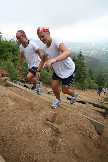 Kelli Stack and Natalie Darwitz climb the incline together