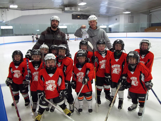 Flat Stanley Cup visiting the Gardner Veterans Ice Arena in Gardner, Mass. with the whole Ash-West/Gardner Mini-Mite team!: Photo submitted by Kelly Hansen