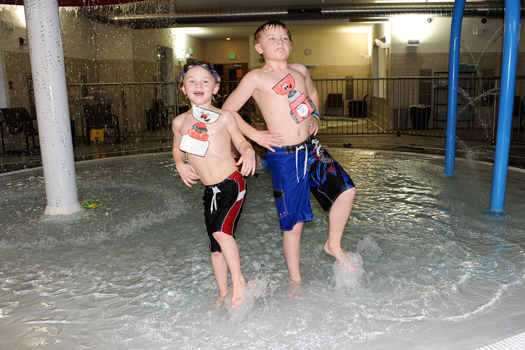 Colter and Bridger Barnett from Fort Peck, Mont., take a swim at the hotel pool in Helena, Mont., during their winter vacation. It turns out Flat Stanley Cup enjoys swimming too!: Photo submitted by Carin Barnett