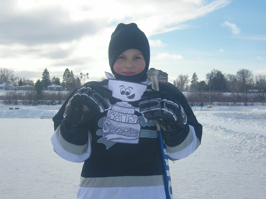 Jared Nelson, of the Superior Ice Bats, and Flat Stanley Cup at the 2011 Pond Hockey Tournament in Superior, Wis.: Photo submitted by Haley Nelson