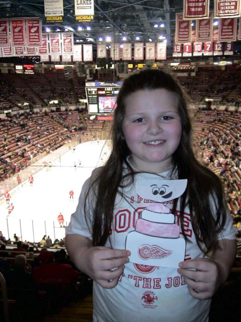 Flat Stanley Cup cheers on the Red Wings at the Joe during a game against the New Jersey Devils.: Photo submitted by Debbie Bordeau