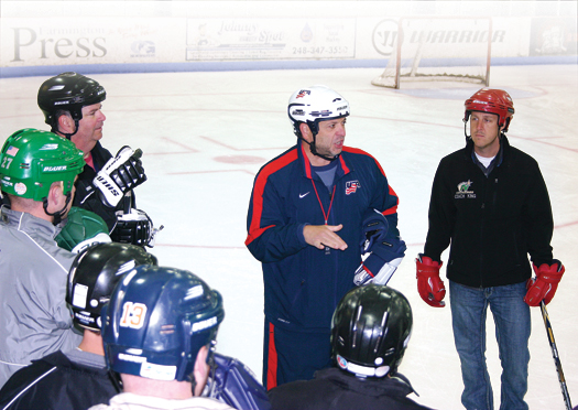 ADM Regional Manager Bob Mancini conducts the on-ice sesson as part of a Level 4 Coaching Clinic in Livonia, Mich.