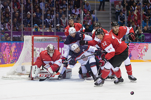 U.S. Men's Team Captain Zach Parise and Ryan Kesler storm the net in search of the tying goal against Canada in the semifinals.