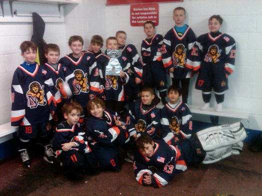 Flat Stanley Cup with the Nassau County Mite Lions in Darien, Conn.: Photo submitted by Stacy Allen