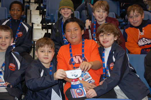 The Nassau Islanders show Flat Stanley Cup the Nassau Veterans Memorial Coliseum during the New York Islanders Lighthouse International Youth Hockey Tournament.: Photo submitted by New York Islanders