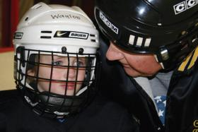 Bill Harrie works with the newest skaters like 4-year-old Waylon Muirbrook. Harrie sticks with them until they feel comfortable on the ice.