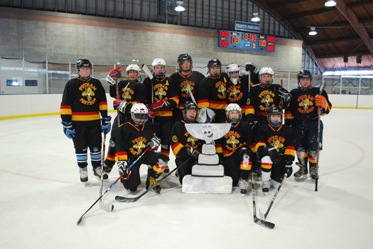 Flat Stanley Cup spent the day with Putnam Hockey in Pawling, New York at the Putnam Panthers Ice Carnival, pictured here with the Bantams. Everyone enjoyed having Flat Stanley Cup as our guest.